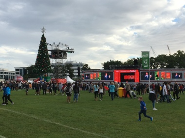 Coca Cola Christmas in the Park - an Auckland tradition with performers singing carols and pop songs!